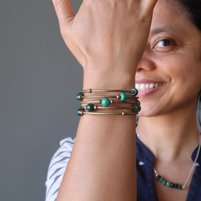 Sheila of Satin Crystals wears her designer Malachite Accordion of Love Bracelet while smiling