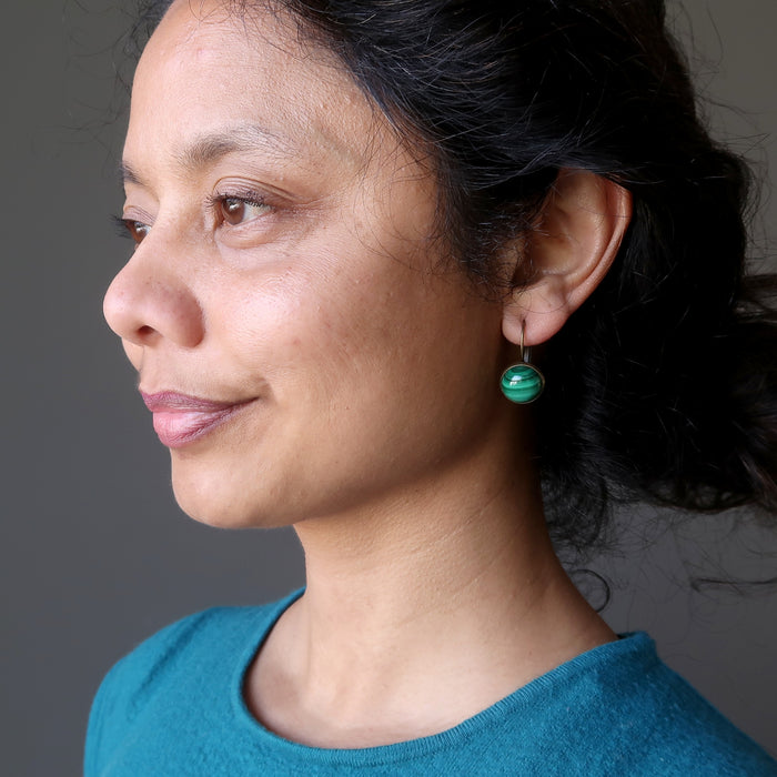sheila of satin crystals wearing malachite bronze leverback earrings