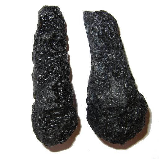 Set of two black tektite wand like meteorites that came from outer space to China. They are glassy and porous.