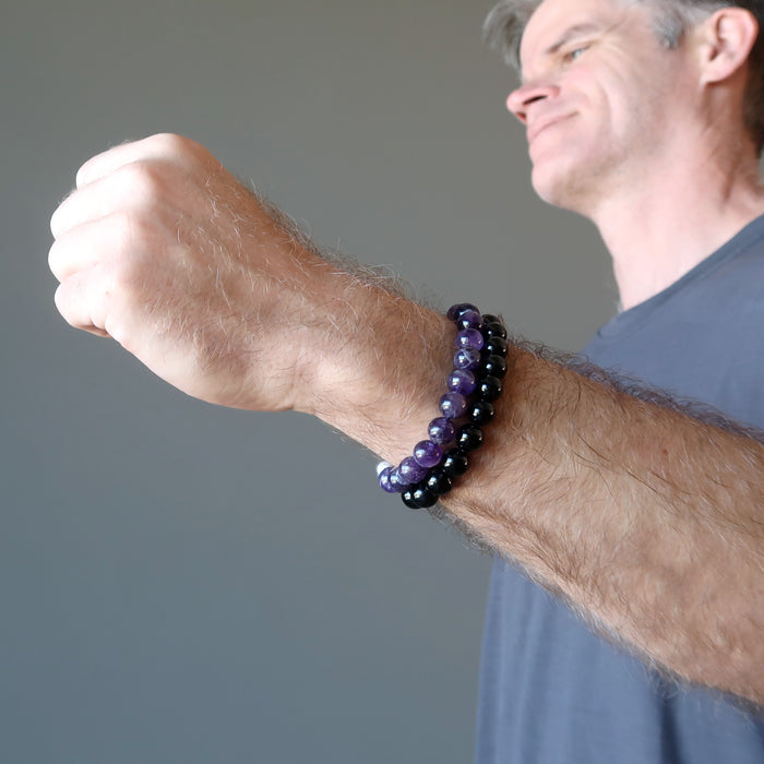 ryan of satin crystals wearing an amethyst and tourmaline bracelet set