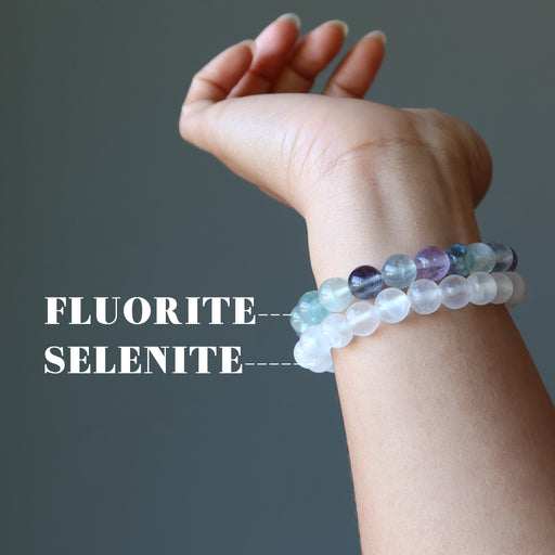 hand model showing off the fluorite and selenite bracelet combo on her wrist