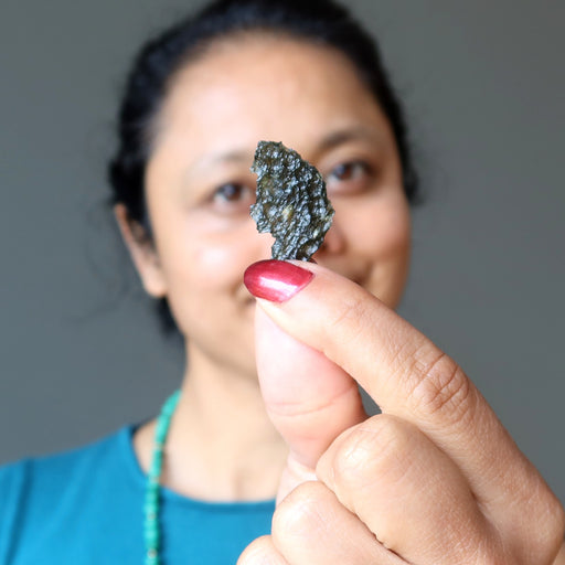 sheila of satin crystals holding real moldavite