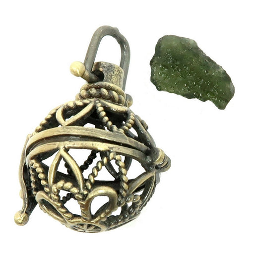green moldavite raw gemstone and a fancy brass cage locket pendant