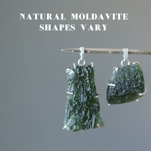 two large raw moldavite in sterling silver pendants