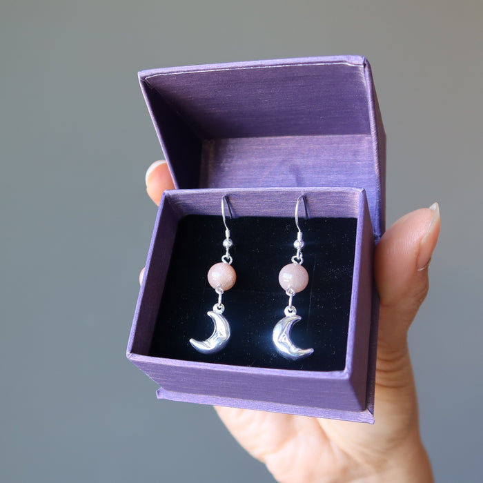 sheila of satin crystals wearing peach moonstone sterling silver crescent moon dangle earrings in purple satin crystals gift box