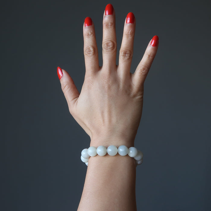 hand wearing white moonstone bracelet