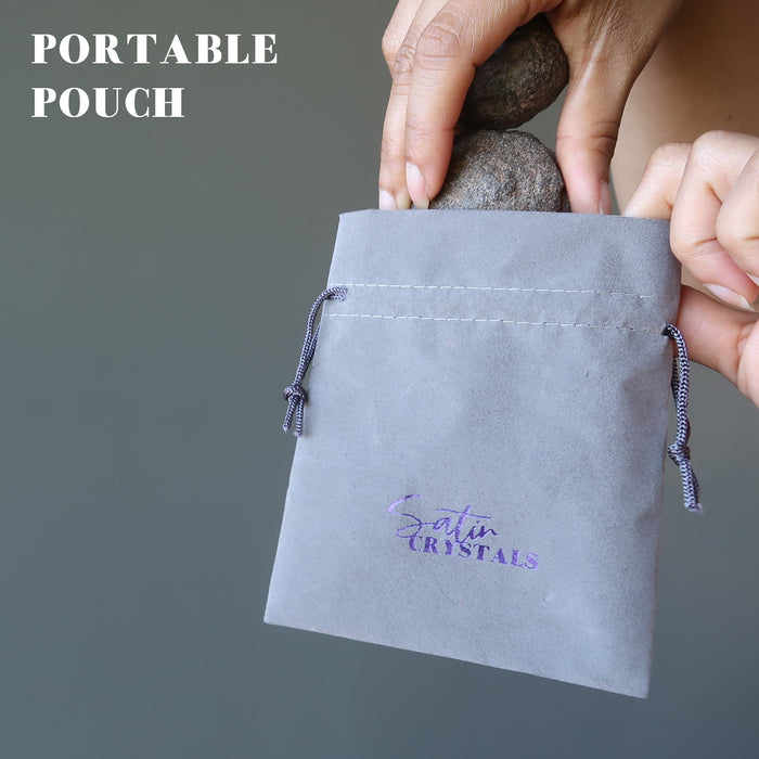 placing pair of moqui marble stones in satin crystals pouch