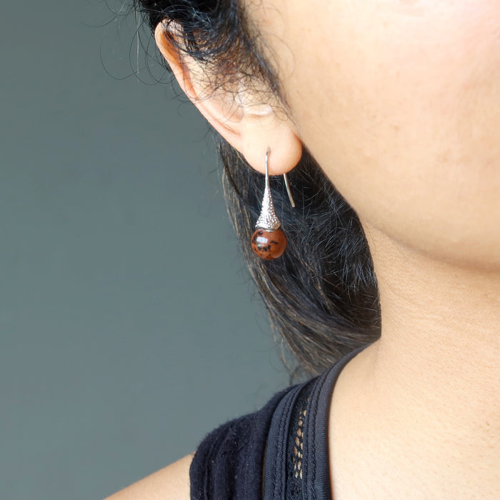 sheila of satin crystals wearing mahogany obsidian in silver dangle earrings