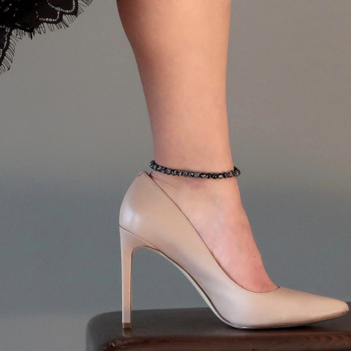 snowflake anklet on a leg in stiletto heels