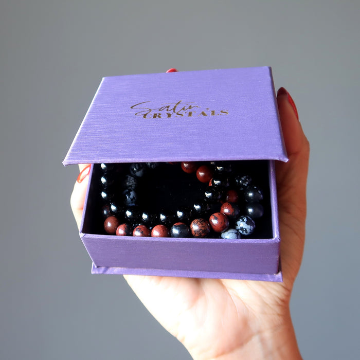 the triple obsidian bracelet set in a satin crystals purple gift box