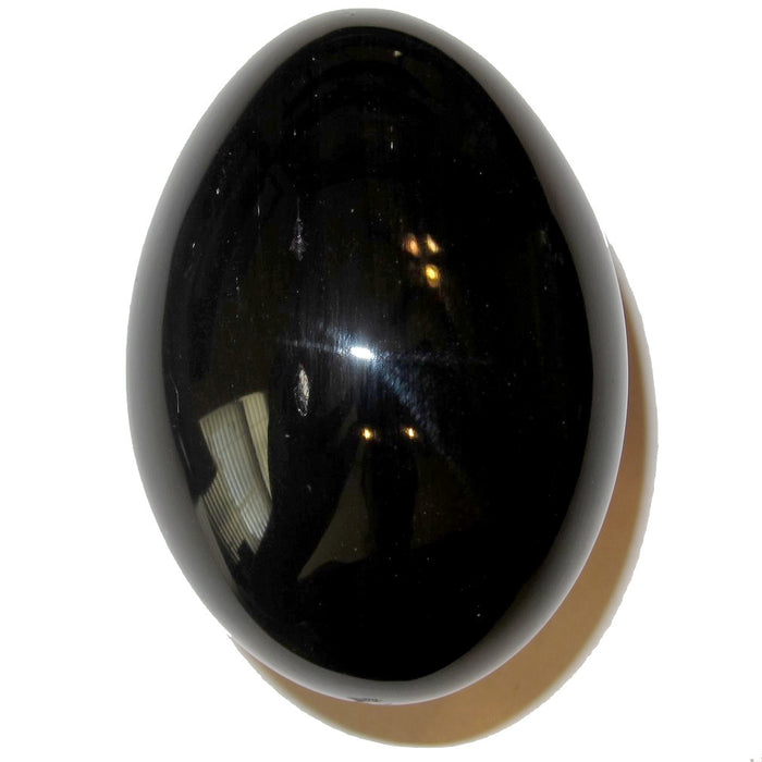 silver obsidian egg looks black in normal lighting before placed in sunlight to reveal flash