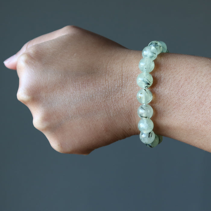 spring green prehnite gemstone bracelet on a lady's wrist