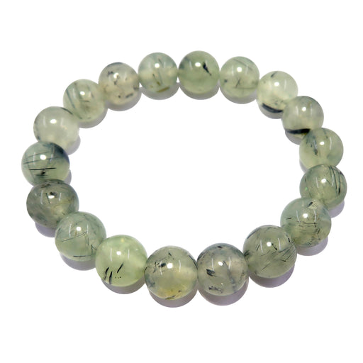 genuine pale green prehnite bracelet featuring black tourmaline mineral inclusions, polished into smooth round beads on stretch cord.