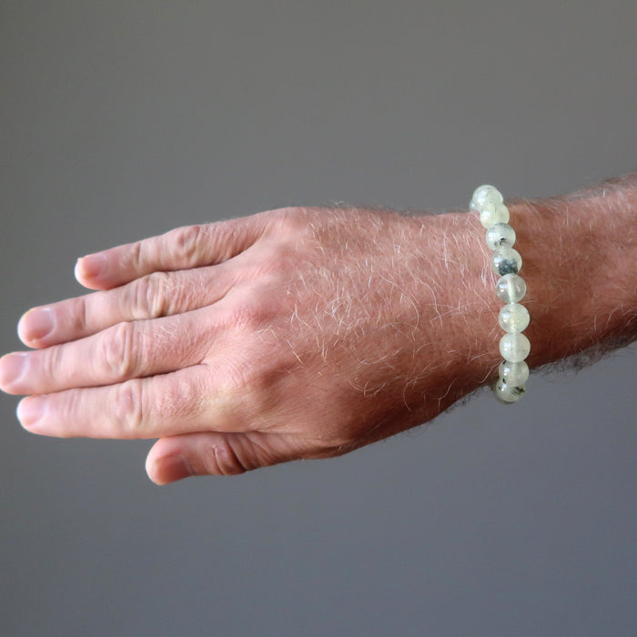 round beaded green prehnite bracelet on a male hand model