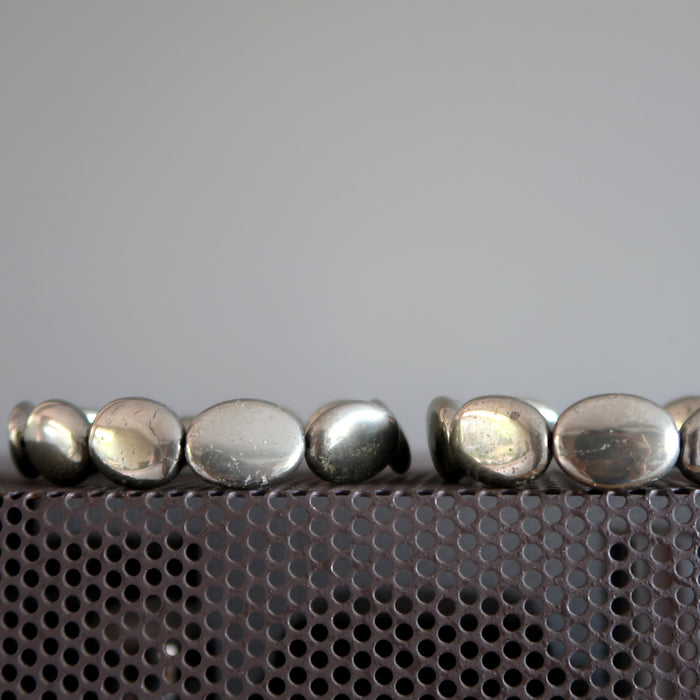 two pyrite oval bracelets
