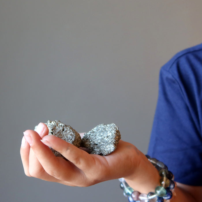 kid holding raw pyrite clusters