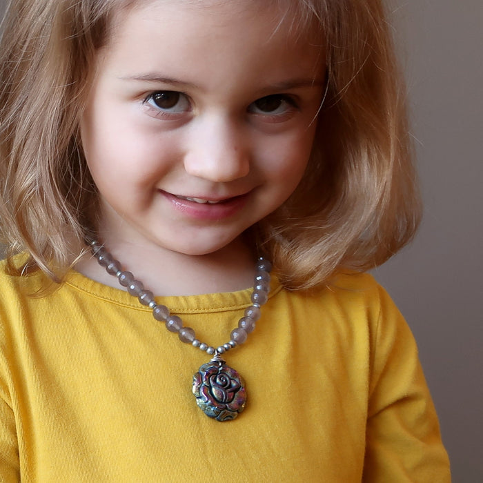 female child wearing pyrite rose and chalcedony necklace