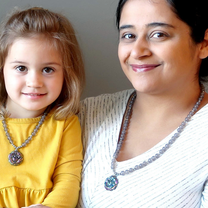 mother and daughter wearing matching pyrite rose necklaces
