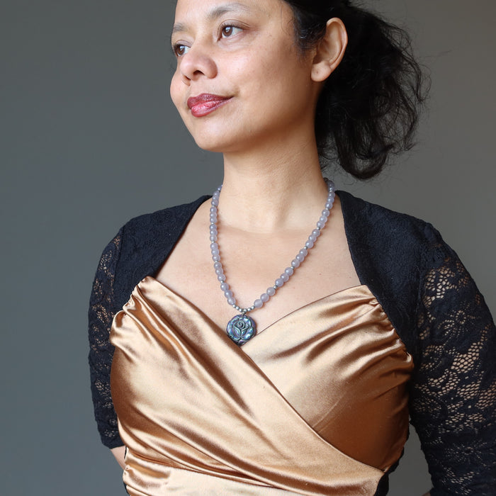 female wearing pyrite rose and chalcedony necklace