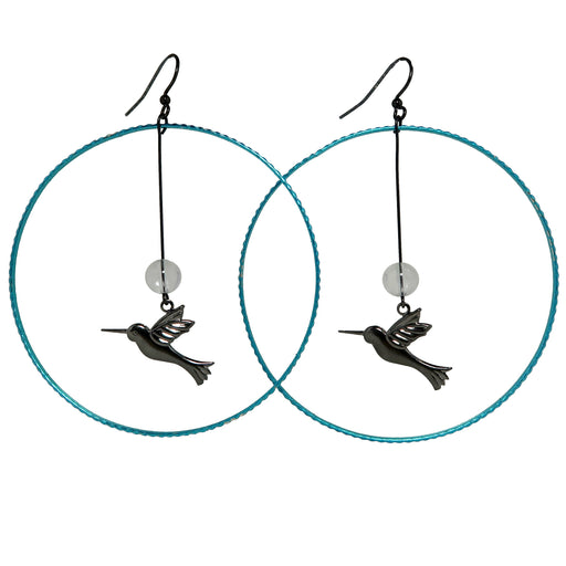 clear quartz beads hanging with hummingbird charms in blue hoop earrings