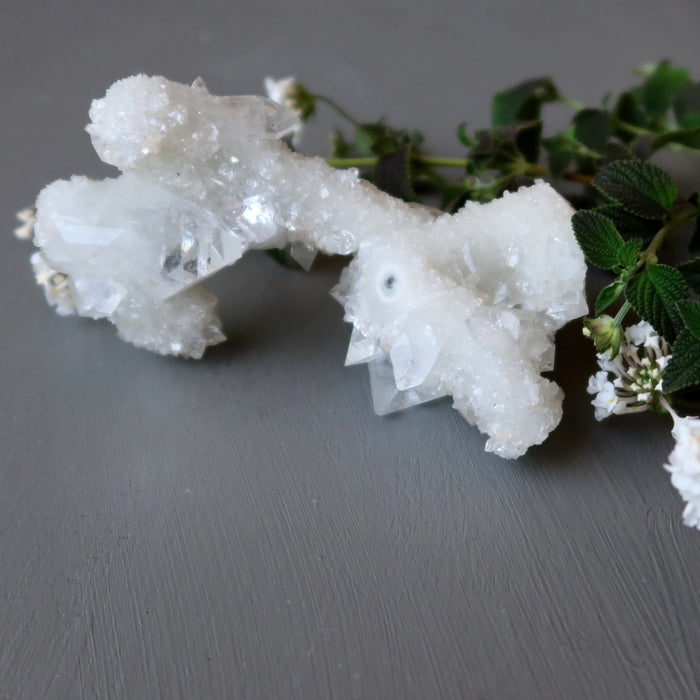 white clear quartz stalagmite cluster and flowers