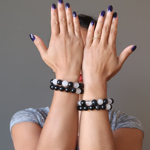 sheila of satin crystals wearing 4 white quartz and black obsidian round beaded stretch bracelets
