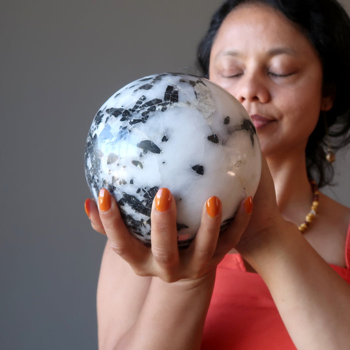 sheila of satin crystals meditating with a quartz tourmaline crystal ball