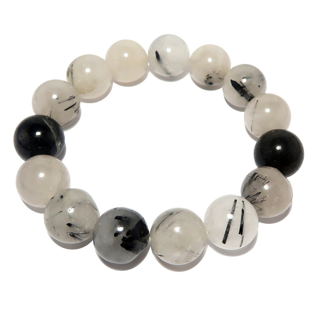 natural round tourmalinated quartz stretch bracelet. handmade beaded stones of clear quartz and black tourmaline inclusions.