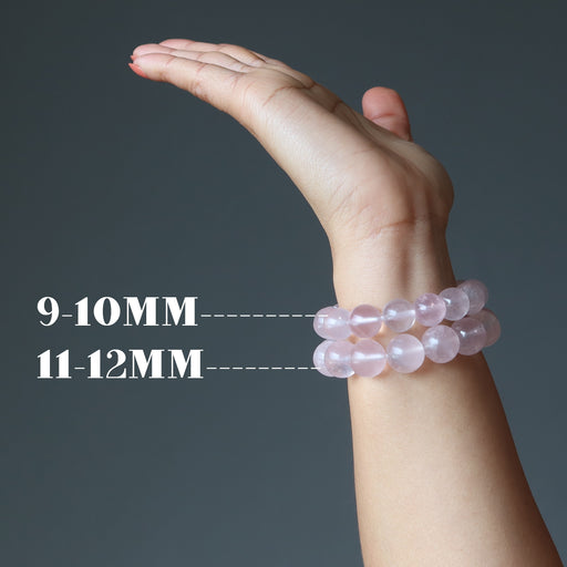 hand wearing two rose quartz bracelet showing size difference in beads