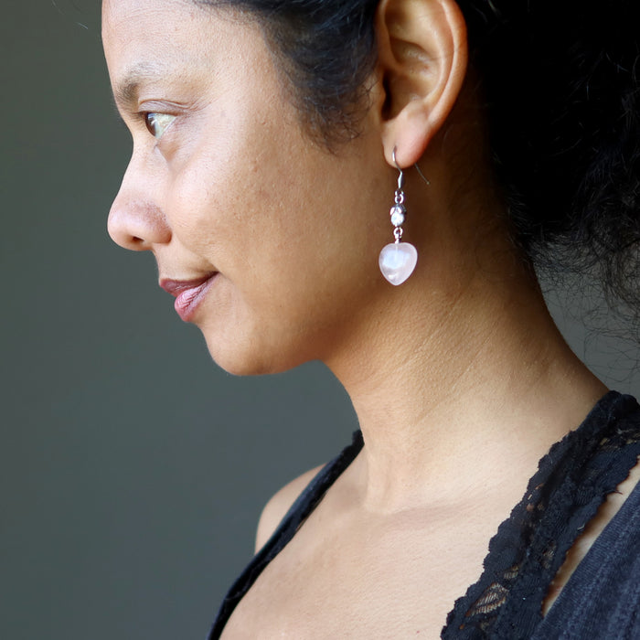 sheila of satin crystals wearing rose quartz heart earrings with sparkling crystal accents