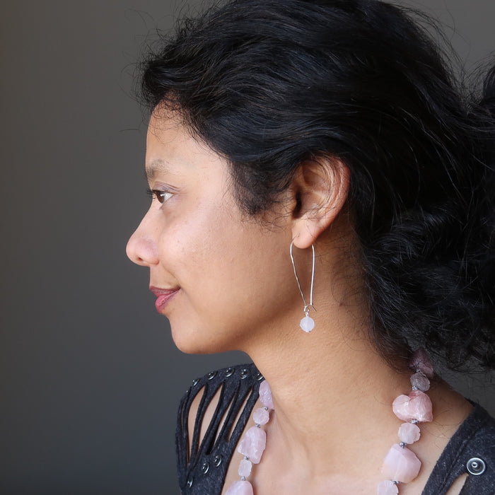 sheila of satin crystals wearing faceted rose quartz on hammered sterling silver earrings