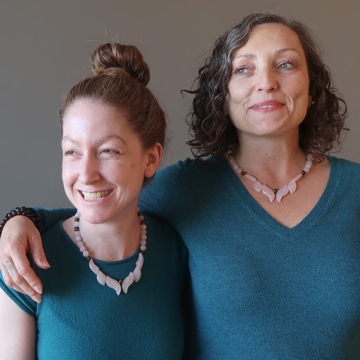 two females wearing rose quartz flame necklaces