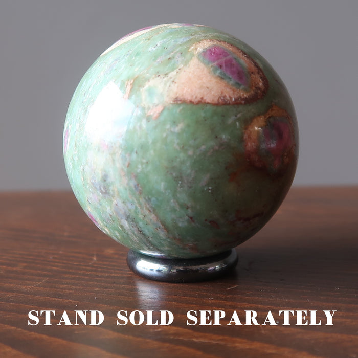 ruby fuchsite sphere on hematine ring stand which is sold separately