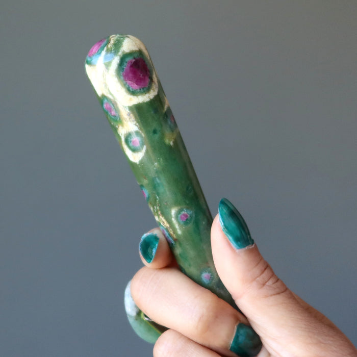 hand holding ruby zoisite tapered massage wand