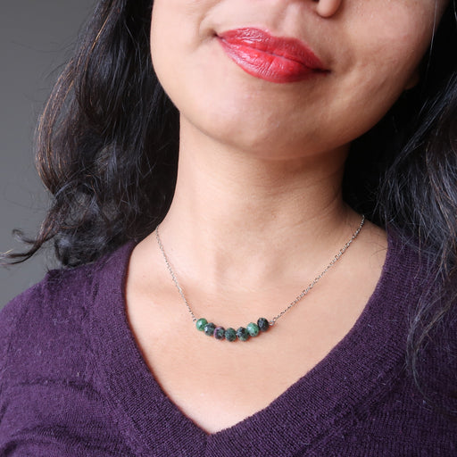 female wearing ruby zoisite necklace