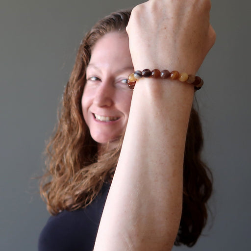 Jamie models a colorful Sardonyx bead bracelet
