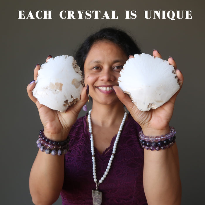 sheila of satin crystals holding raw white scolecite domes
