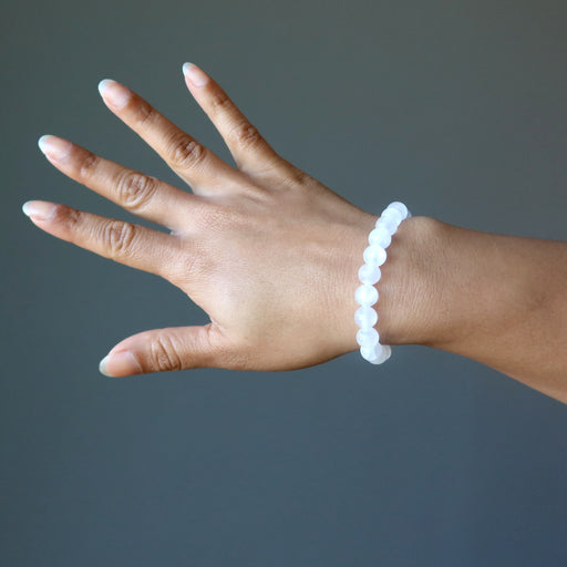 hand wearing a white selenite stretch bracelet