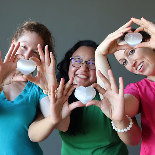 jamie, jessica and holly of satin crystals holding up a white selenite heart each