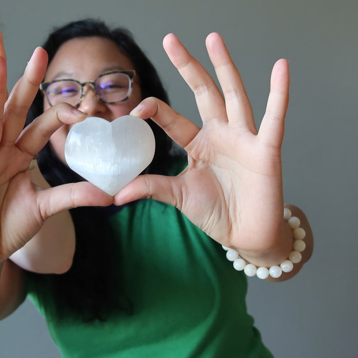 jessica of satin crystals holding a selenite heart