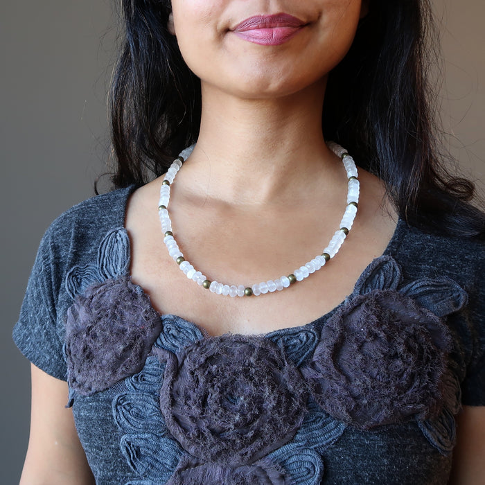 woman wearing white selenite necklace