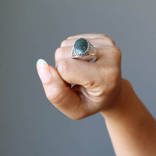 hand holding russian serpentine sterling silver adjustable ring