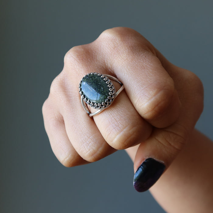 fist wearing russian serpentine sterling silver adjustable ring on middle finger