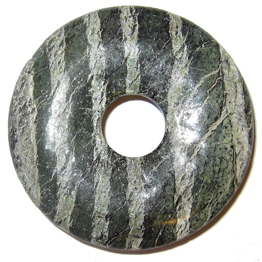 Round gemstone donut pendant made from green Serpentine with white stripes. The amulet has a hole in the center for jewelry making. It is matte polished and one point six inches in diameter.