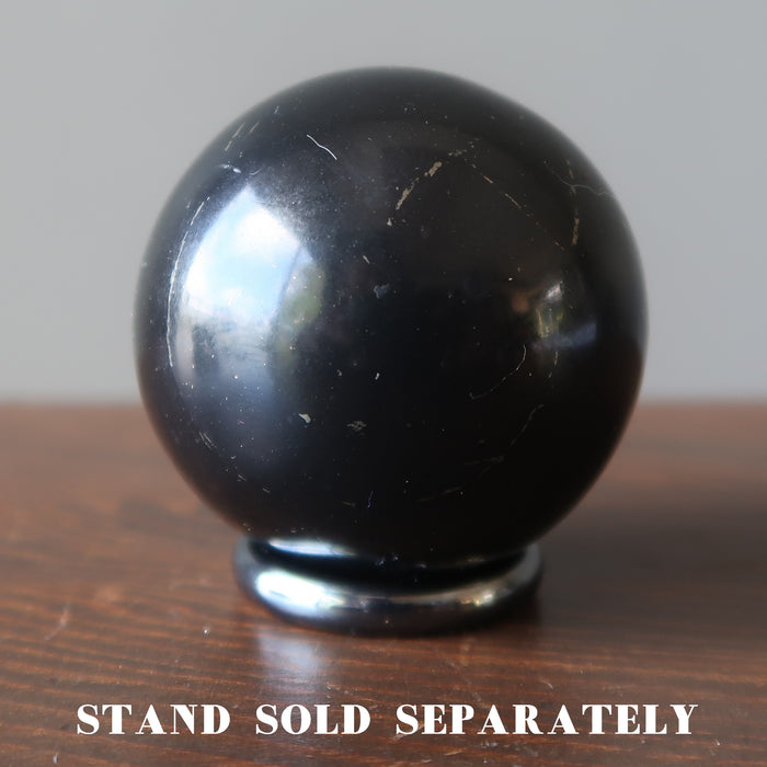 shungite sphere on hematine ring stand which is sold separately