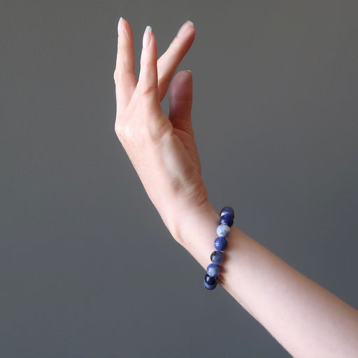 blue sodalite bracelet modeled on an arm
