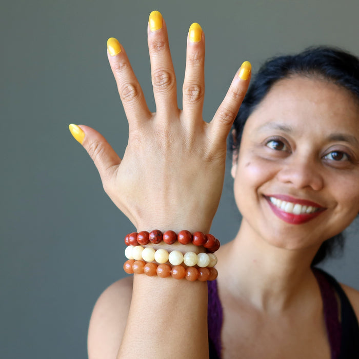 sheila of satin crystals wearing yellow calcite, orange aventurine, red jasper stretch bracelet set