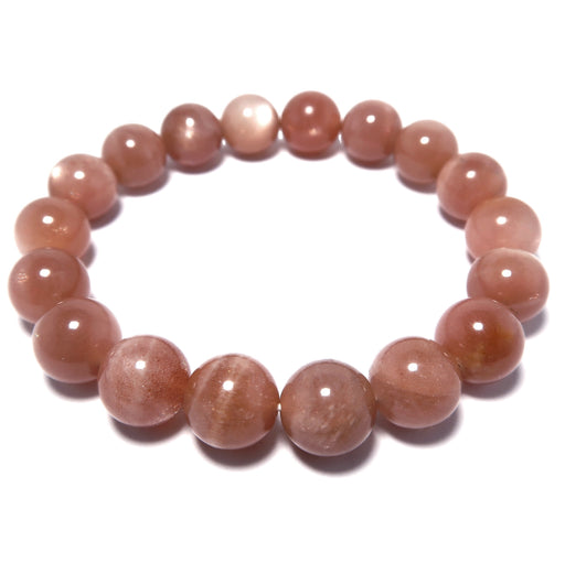 sunstone stretch bracelet with round beads of pink tone and silver sheen