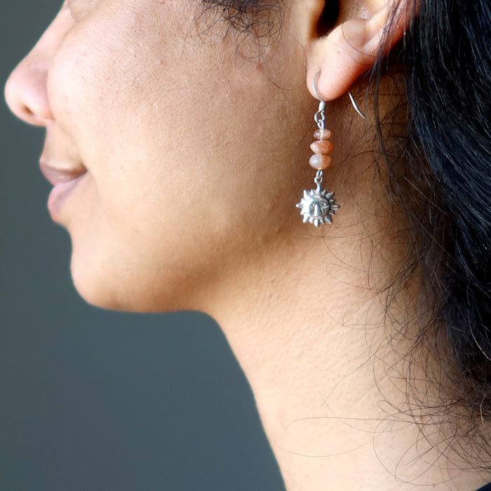 sheila of satin crystals wearing sunstone sterling silver sun earrings
