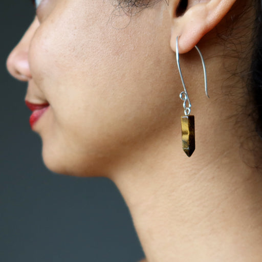 sheila of satin crystals wearing tigers eye point fine silver earrings